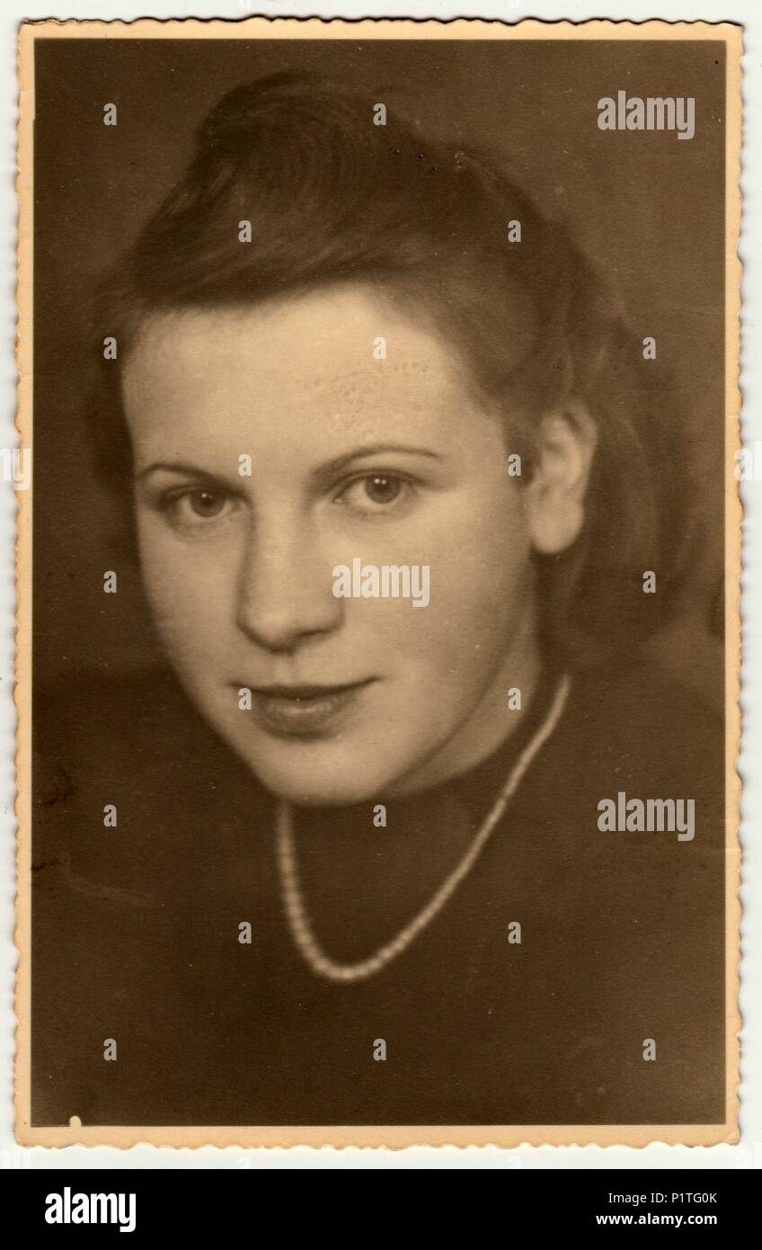 OBERAMMERGAU, GERMANY - CIRCA 1940s: Vintage photo shows the portrait of a young girl. Retro black & white studio photography. - Stock Image