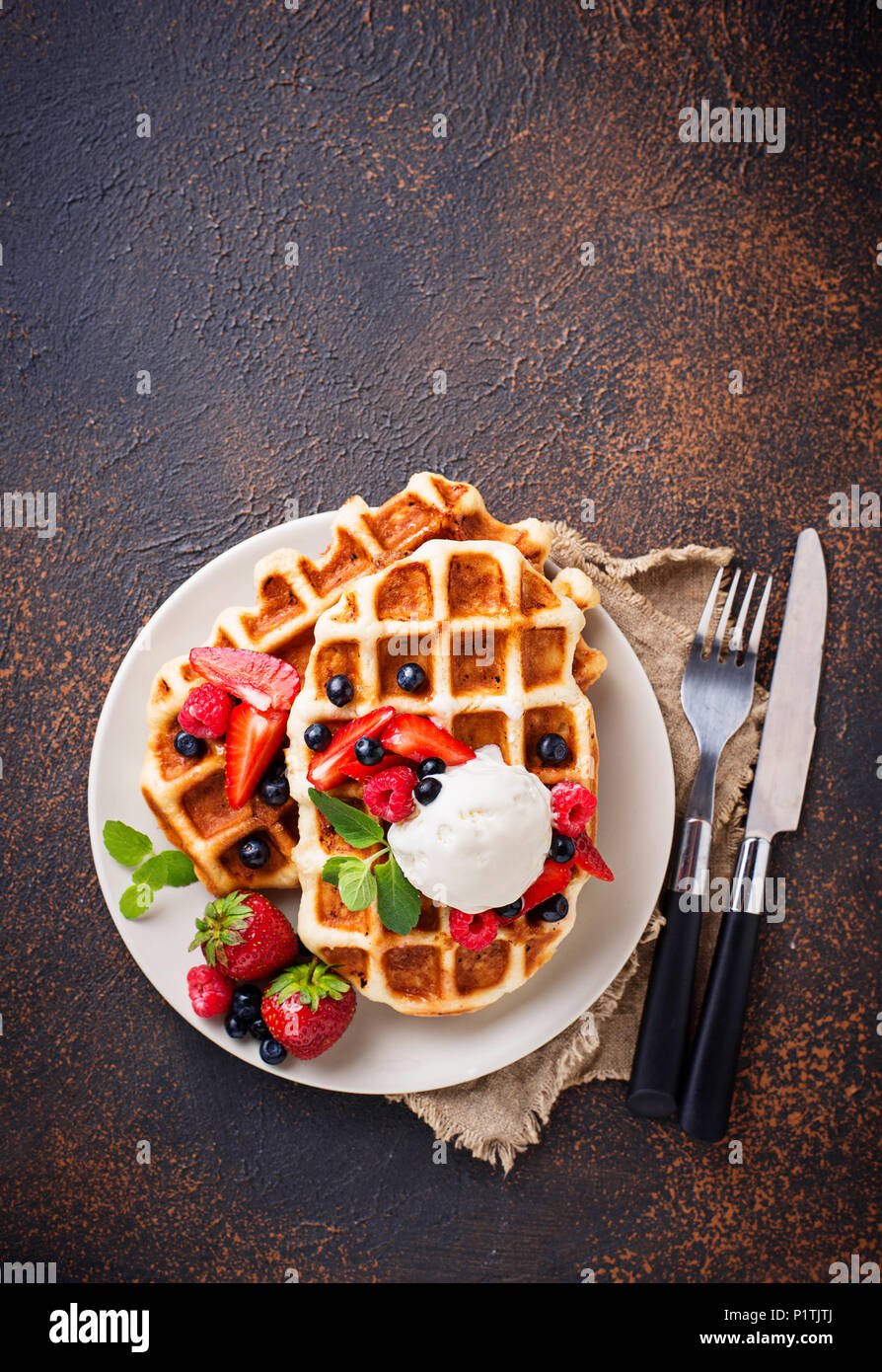 Belgium waffles with berries and ice cream - Stock Image