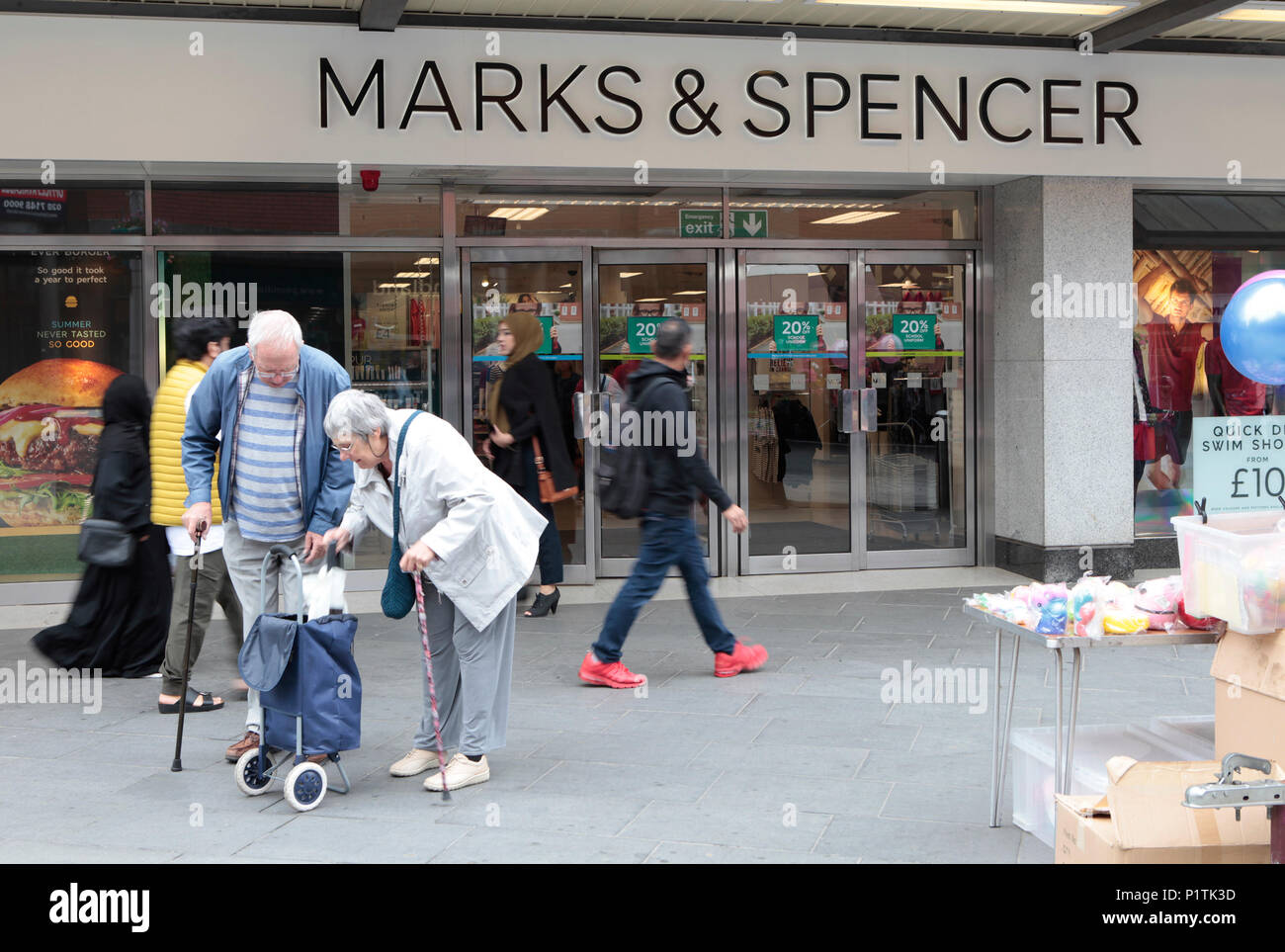 A MARKS AND SPENCER STORE. Shops and people shopping in Harrow, middlesex, London, UK - Stock Image