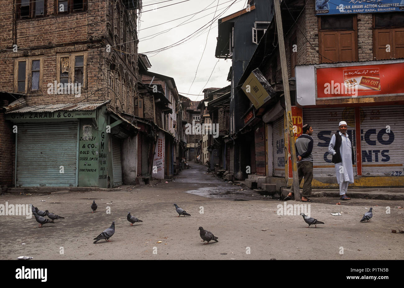 Srinagar, India, men during the exit barrier on the street Stock Photo
