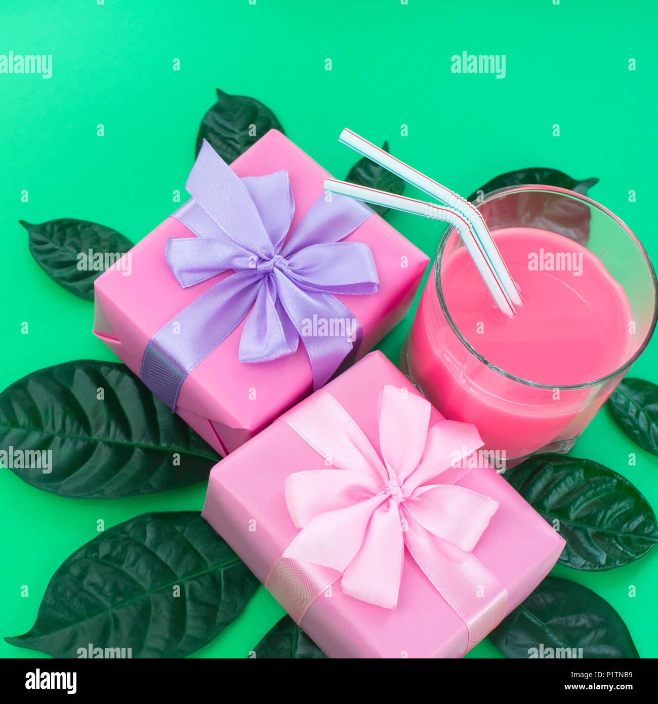 Holiday poster Boxes with gifts a glass of milkshake a bright green ...