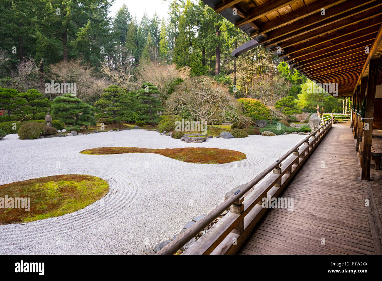 Japanese Building With Wooden Porch And Rock Garden.
