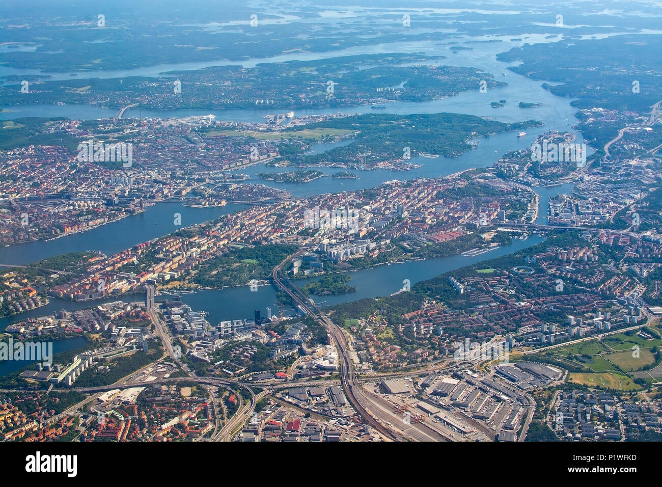 STOCKHOLM, SWEDEN - JUNE 1, 2018: Aerial shot over Stockholm, Sodermalm, Old Town island and Djurgarden, during inflight to Arlanda airport on a sunny Stock Photo