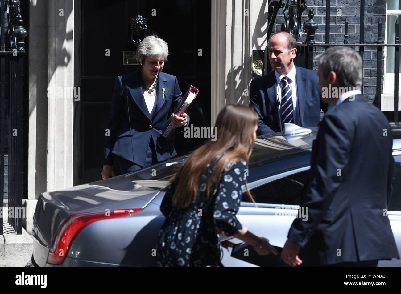 Prime Minister Theresa May leaves 10 Downing Street, London, for the House of Commons to face Prime Minister's Questions. Picture date: Wednesday June 13, 2018. See PA story POLITICS PMQs. Photo credit should read: Stefan Rousseau/PA Wire - Stock Image
