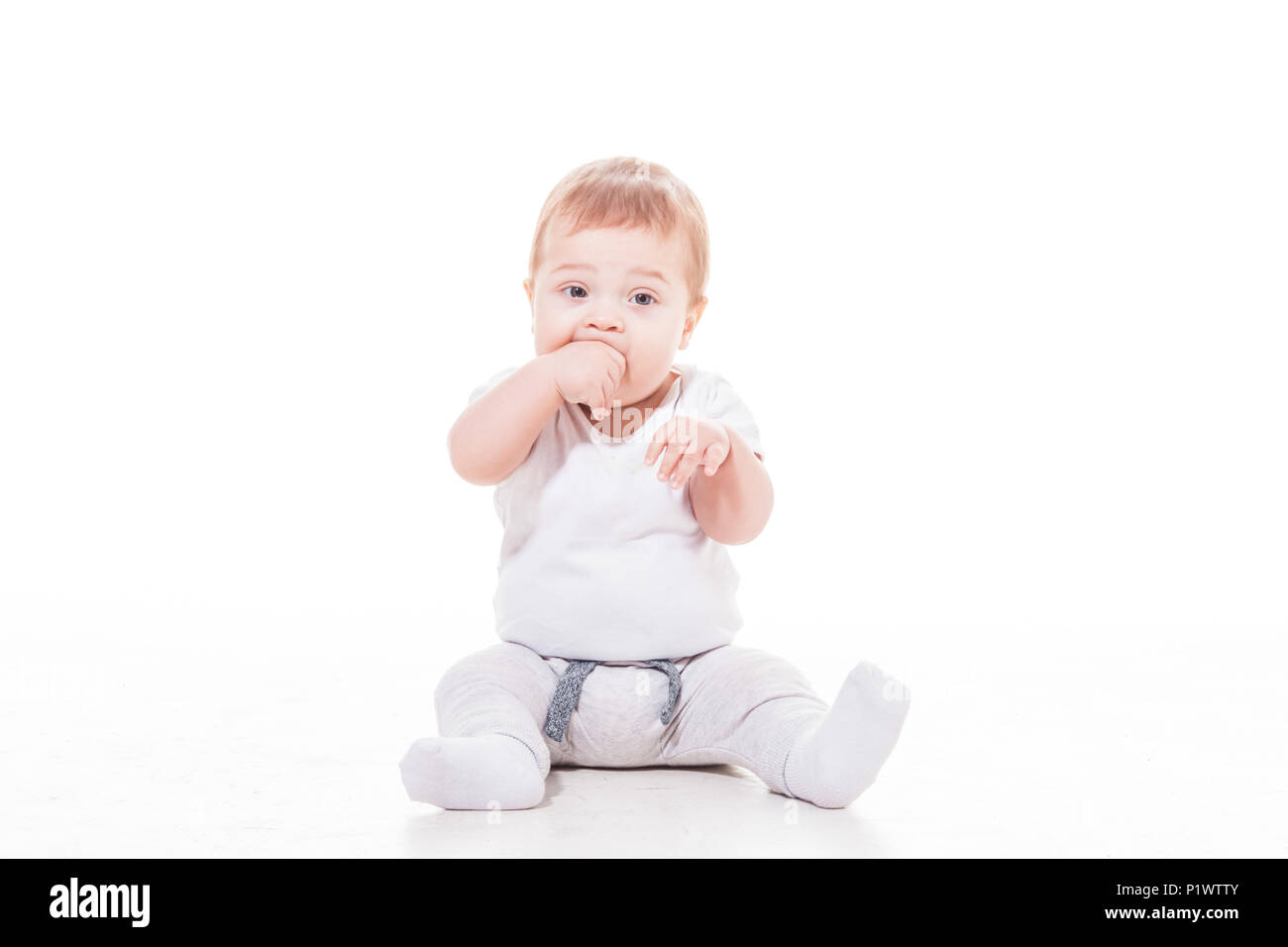 baby feels teething in his mouse - Stock Image