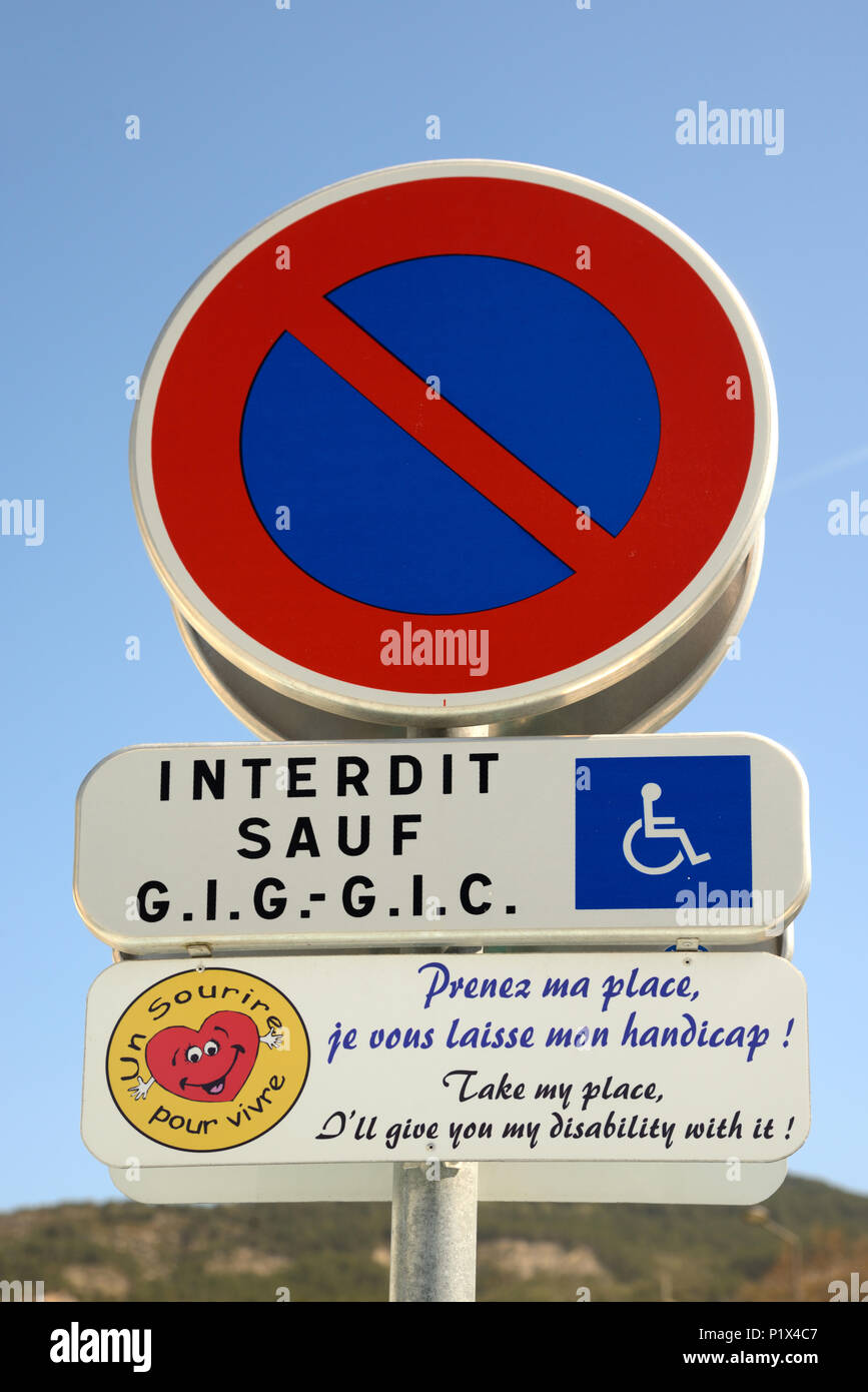 Bilingual French and English Disability Parking Sign France. No Parking Except for Disability Card Holders. - Stock Image