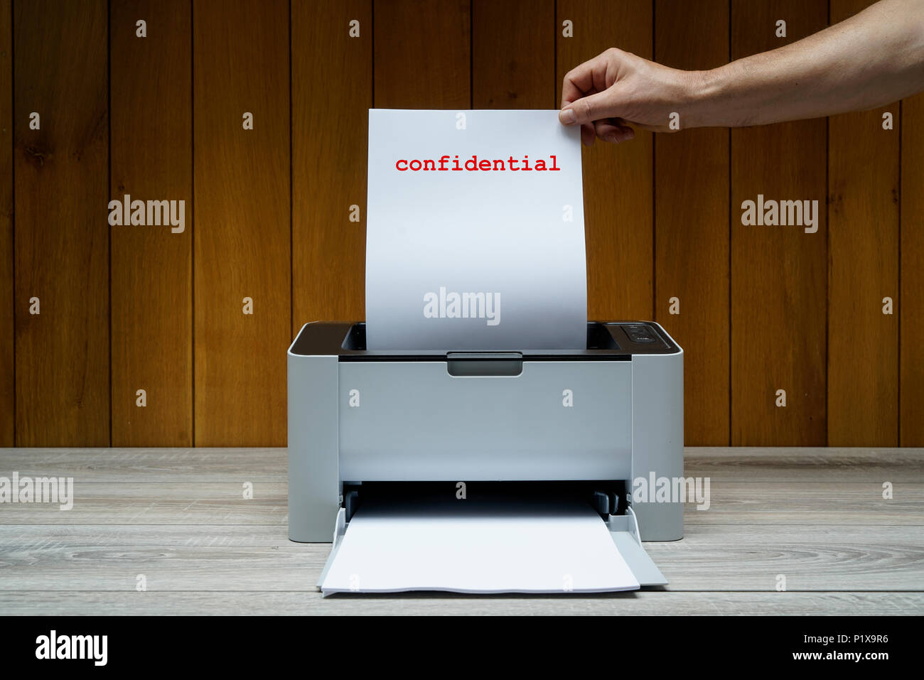 printing a confidential document - Stock Image