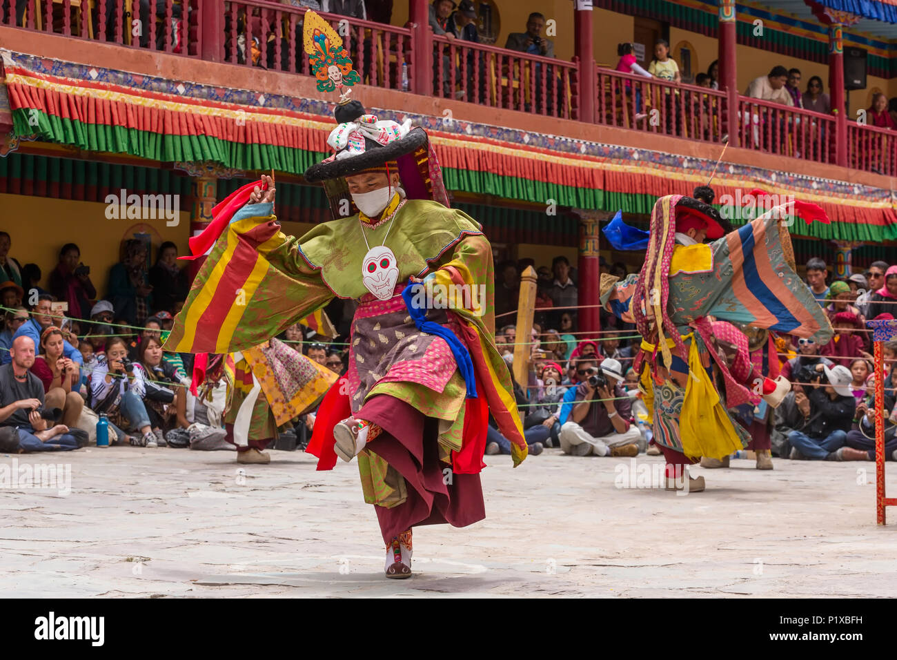 Leh, India - June 21, 2017: Unidentified monks in mask performing a religious masked and costumed mystery dance of Tibetan Buddhism during the Buddhis - Stock Image