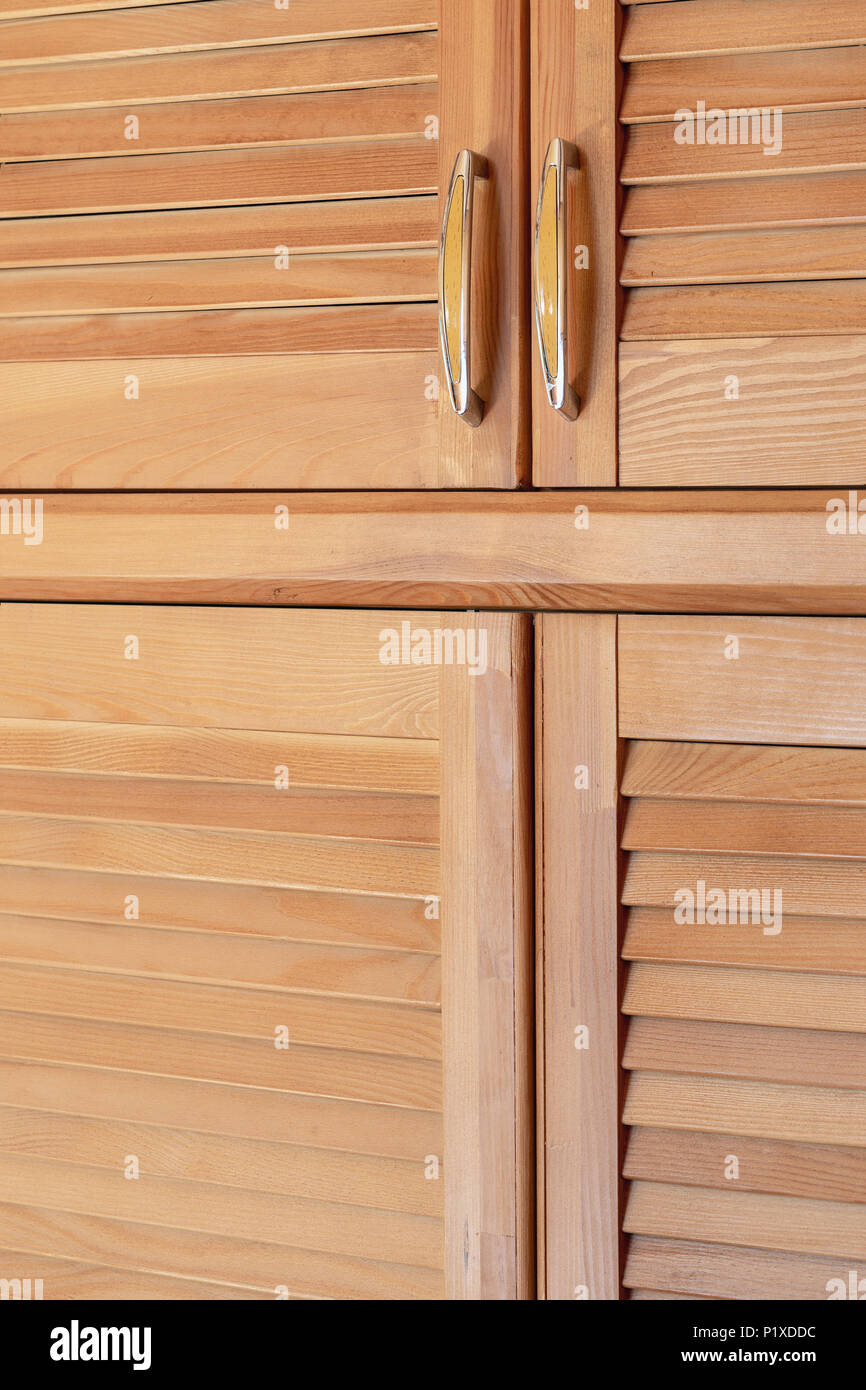 Modern wooden cabinet in classic rustic style. Details of wardrobe case with shutter plank doors. Country house interior. & Modern wooden cabinet in classic rustic style. Details of wardrobe ...