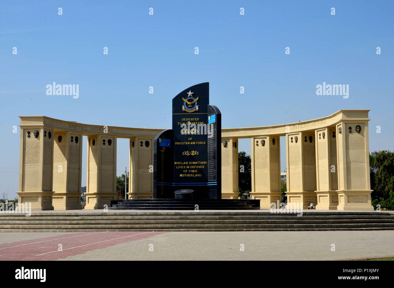 Pakistan Air Force Martyrs Monument with names and symbol honoring dead Pakistani airmen at PAF Museum Karachi Pakistan - Stock Image