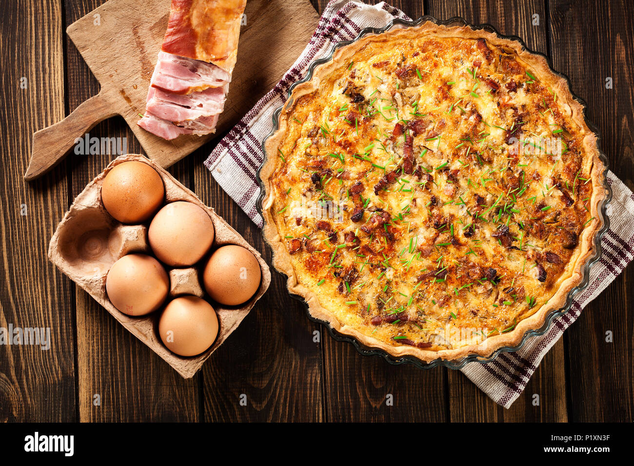 Homemade quiche lorraine with bacon and cheese. French cuisine - Stock Image