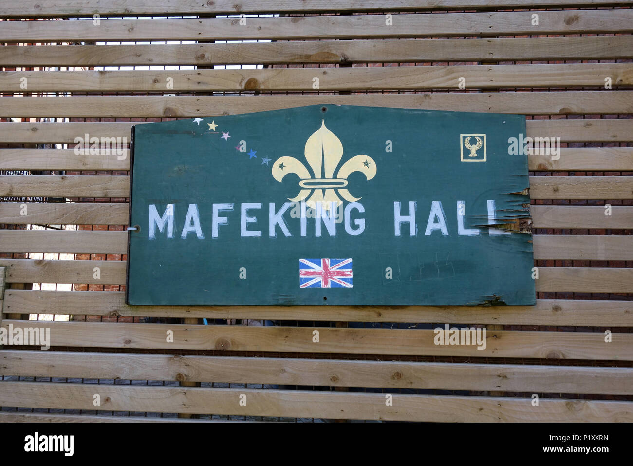 Weathered sign outside a scout hut called Mafeking Hall. - Stock Image