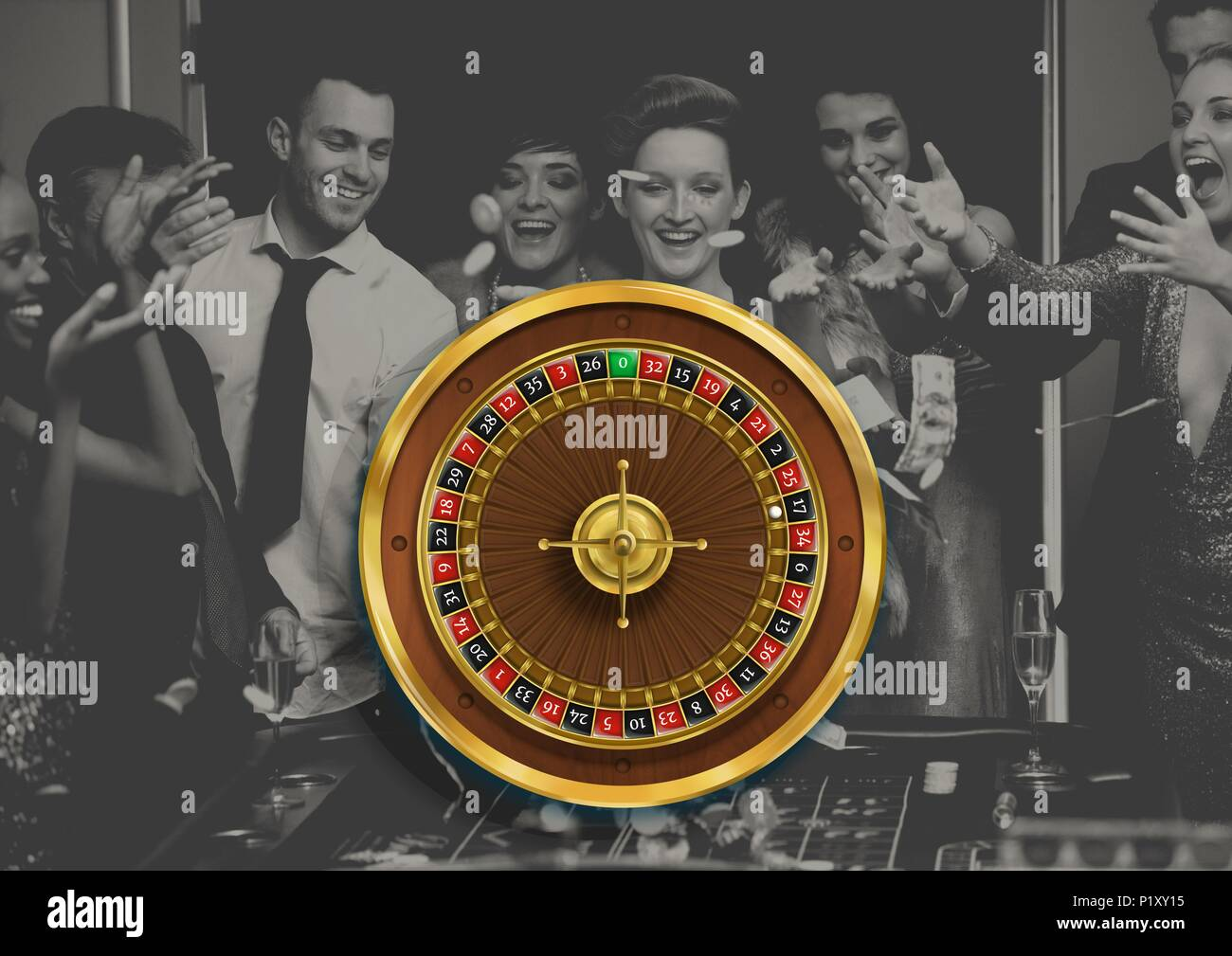 Roulette wheel and people playing in casino - Stock Image