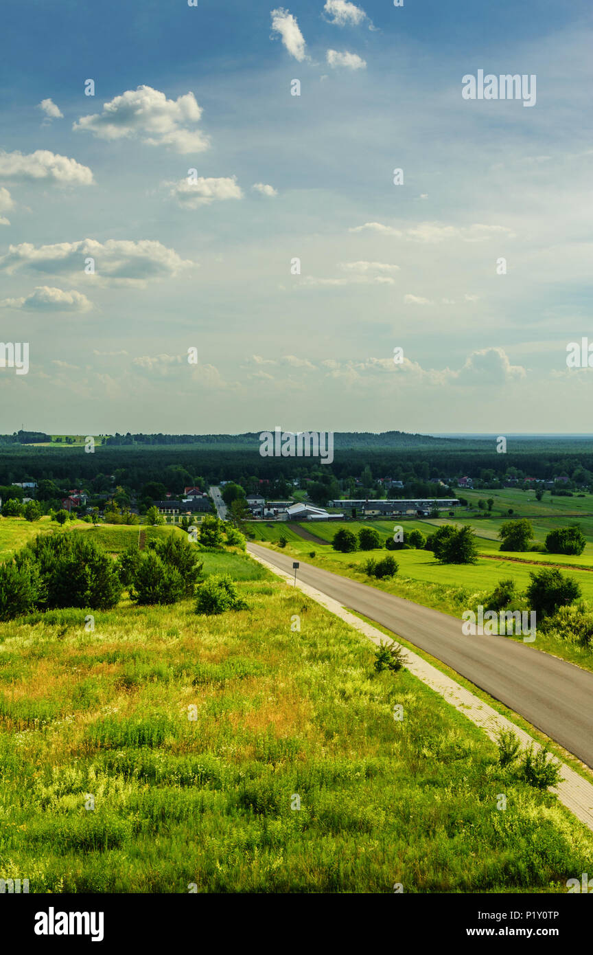 A spectacular view of the valley with the village and empty highway - Stock Image