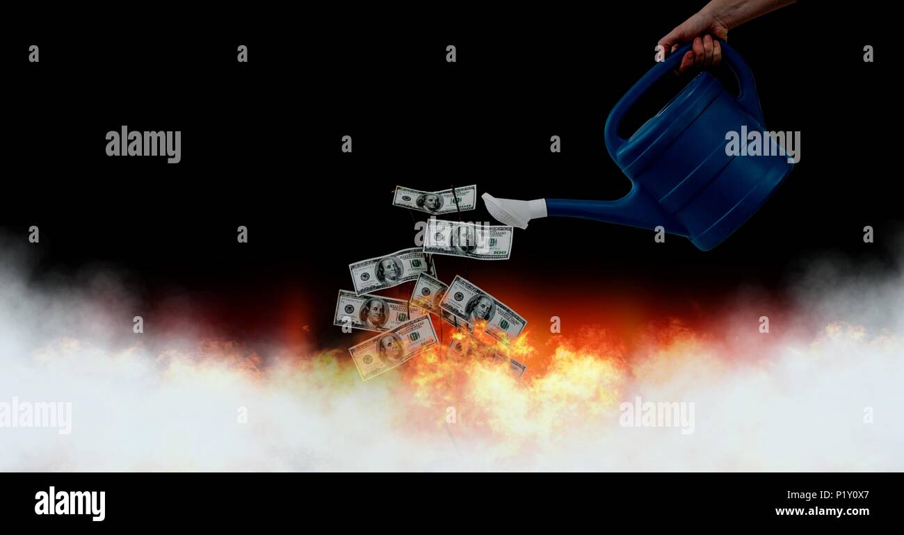 Wasting money notes into burning fire - Stock Image
