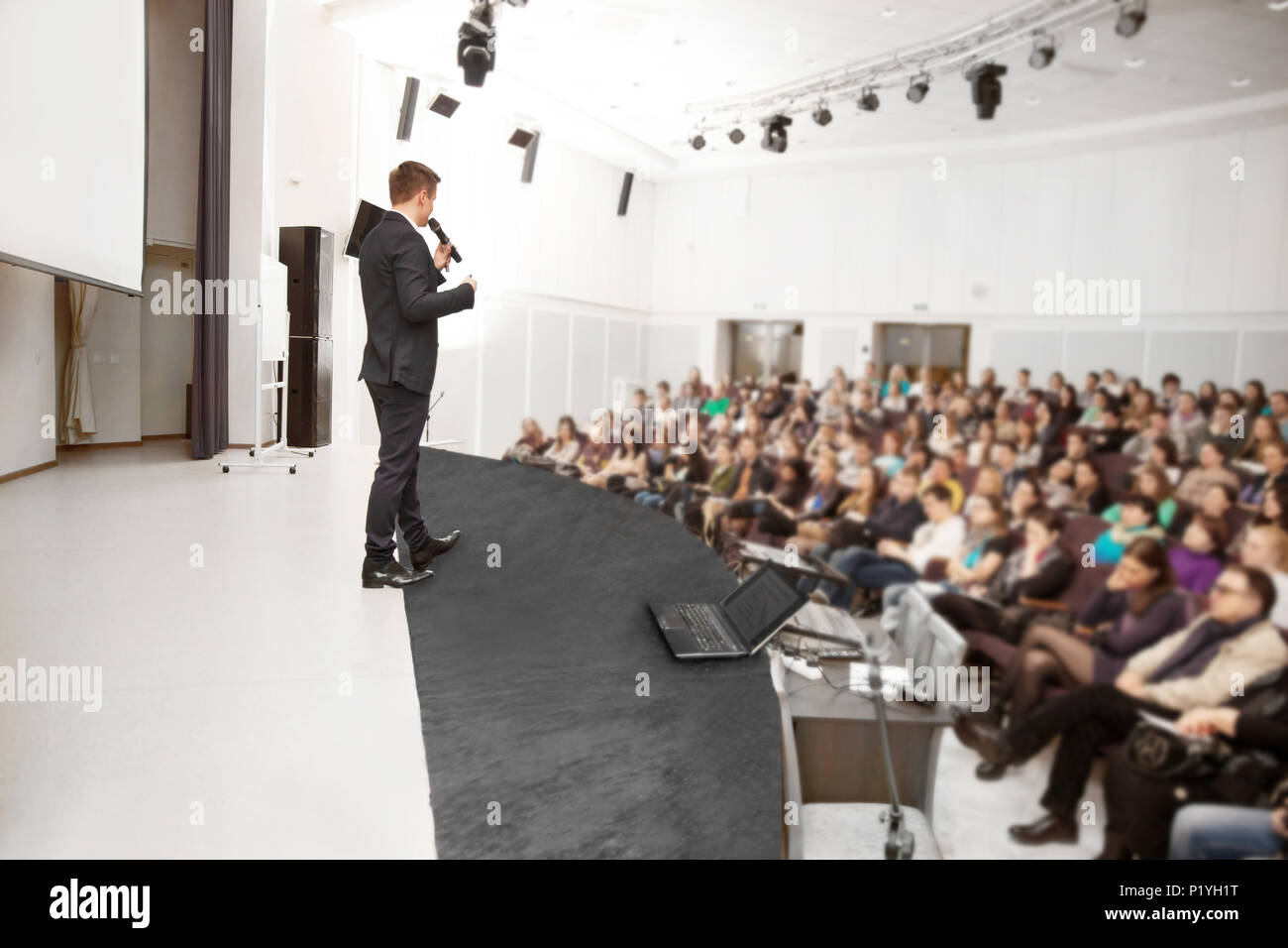 Speaker at a business conference and presentation. - Stock Image
