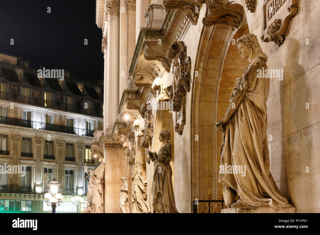Paris, 9th arrondissement, night Palais Garnier. Sculpture on the front. Stock Photo