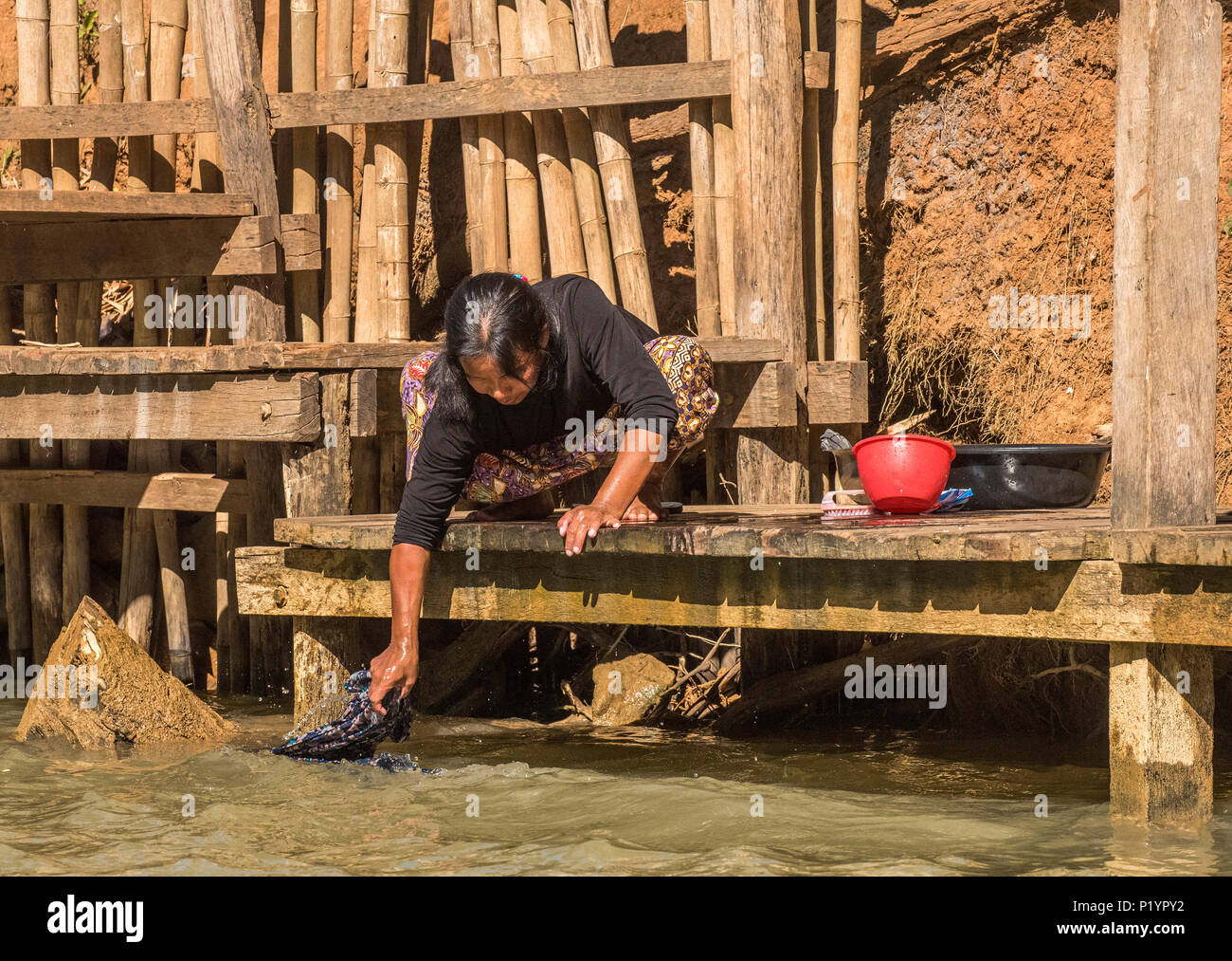 Myanmar, Shan State, Lake Inle, doing the laundry on the shore of the Inn Thein canal Stock Photo