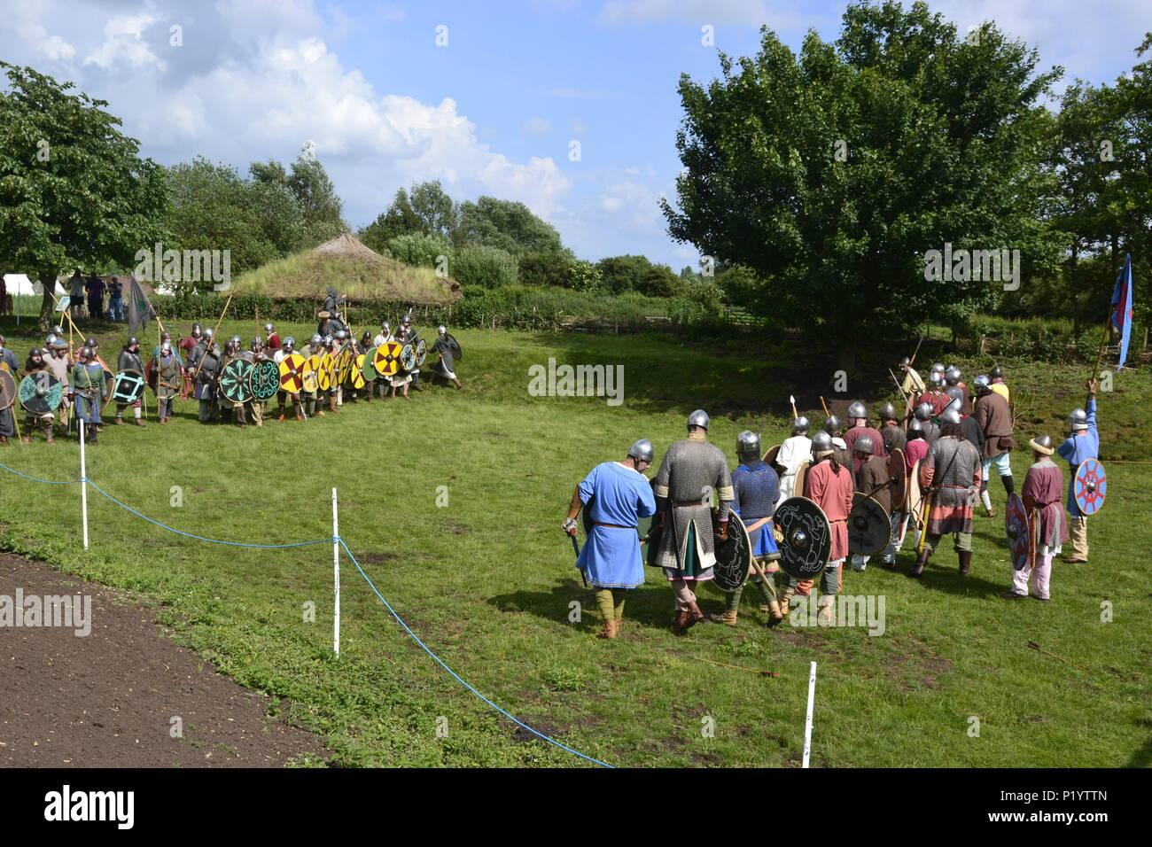 Battle at Flag Fen Archaeology Park, home of an prehistoric wooden causeway. Anglo-Saxon Re-enactment Event, Peterborough, Cambridgeshire, England, UK - Stock Image
