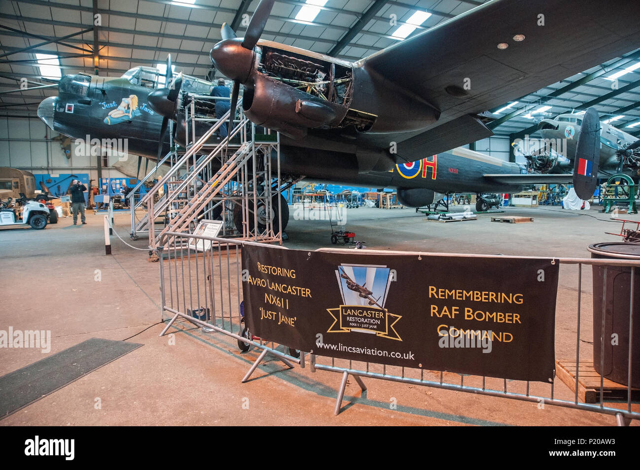 Avro Lancaster NX611 Just Jane in her hangar at the Lincolnshire Aviation Heritage Centre  East Kirkby. She is slowly being made airworthy. - Stock Image
