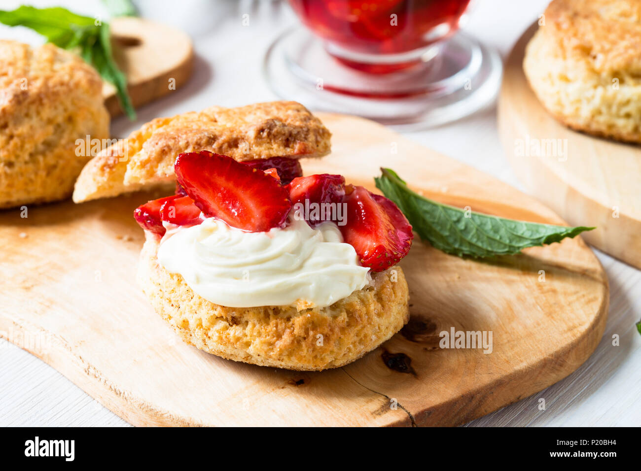 Homemade strawberry shortcake with vanilla whipped cream and berry compote Stock Photo