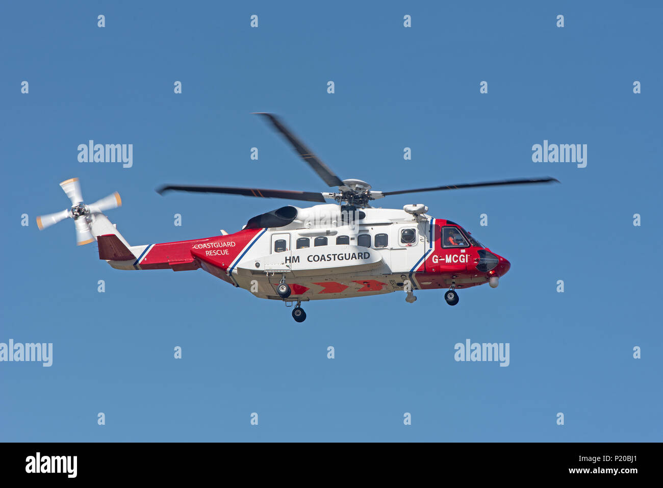 HM Coastguard S-92 rescue Helicopter returning to it's base at Inverness Airport in the Scottish Highlands. Stock Photo