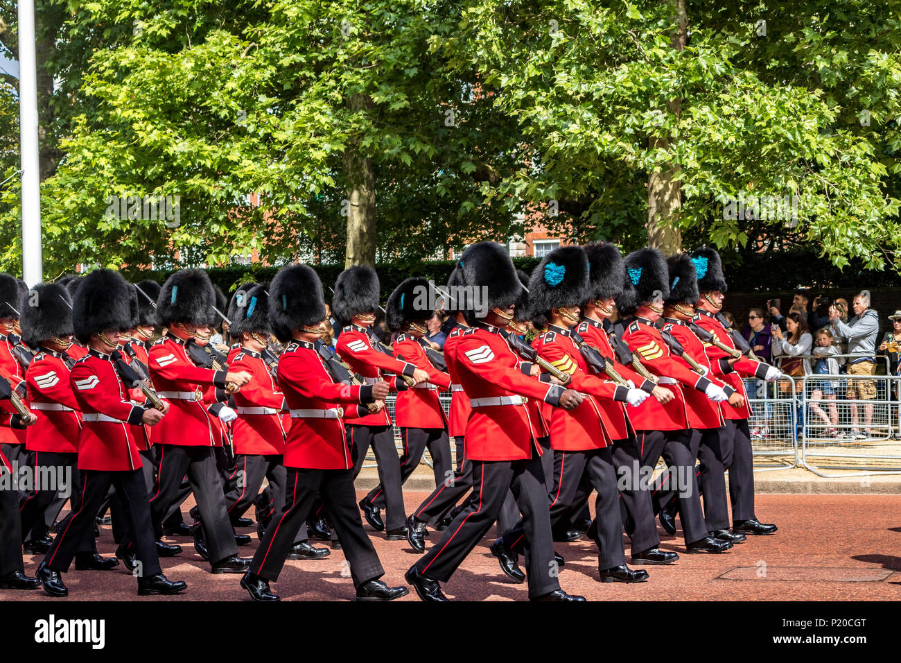 Soldiers of The Irish Guards marching along the Mall at The Trooping Of The Colour / Queen's Birthday parade 2018 Stock Photo