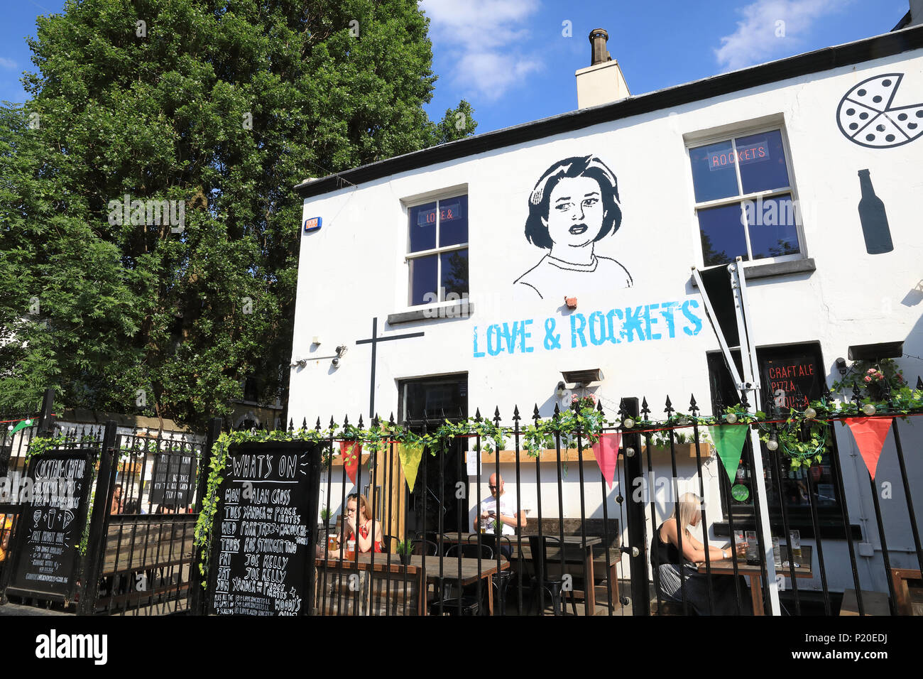 Quirky and bohemian shops, cafes and restaurants line Lark Lane off Sefton Park, in Liverpool, UK - Stock Image