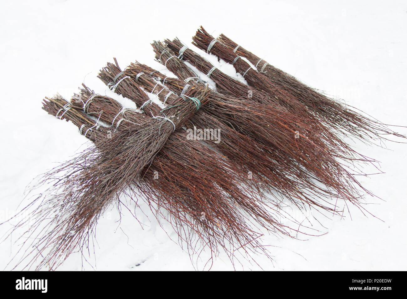 Many brooms from dry tree branches.Besom - Stock Image