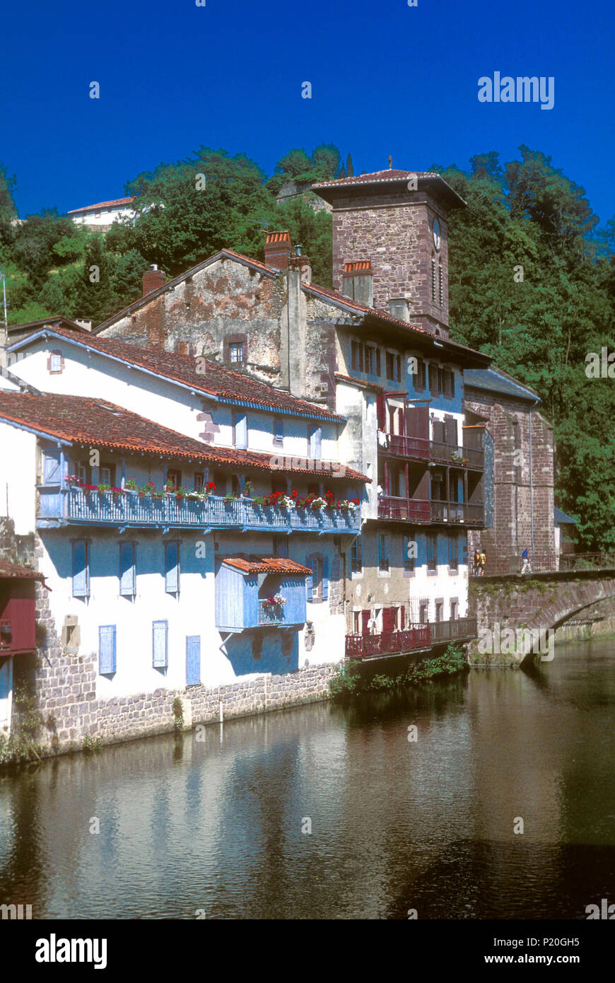 France, Basque Country, houses on the edge of the Nive river in Saint Jean Pied de Port (labelled 'Most Beautiful Village in France') - Stock Image