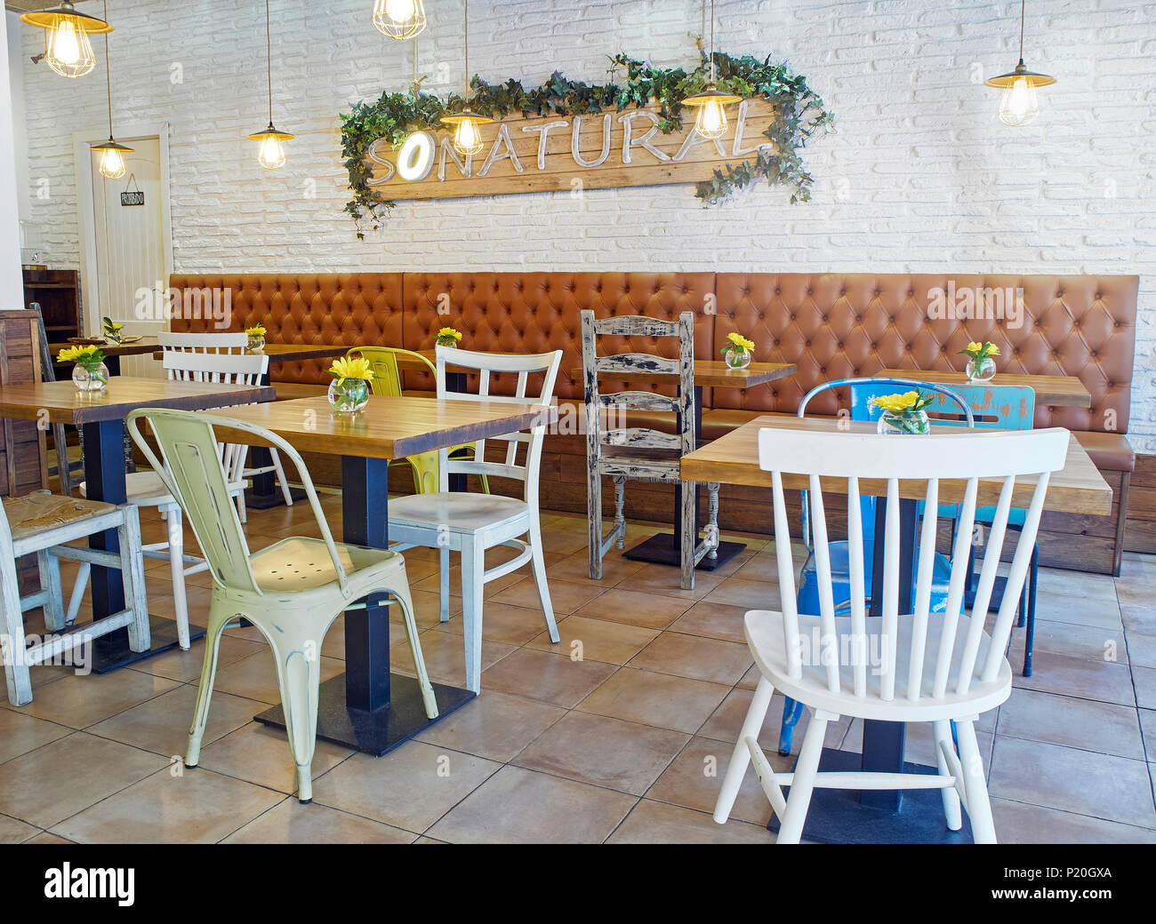 Cozy Vintage Style Coffee Shop Interior With A White Brick Wall