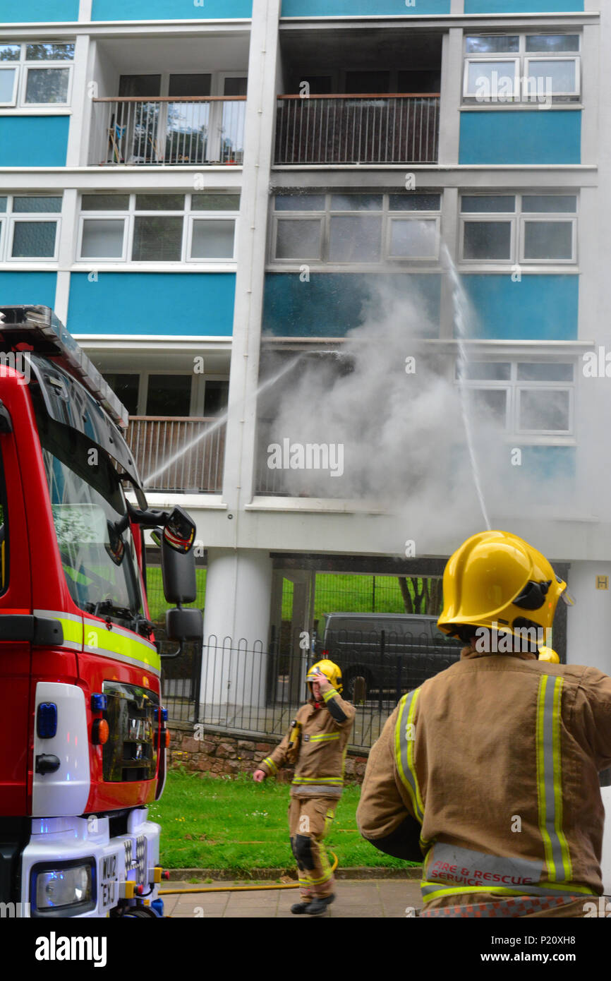 Bristol, UK. 13th Jun, 2018.  Block of flats on fire seen with smoke pouring out at Brandon House on  Jacob's Wells Road. Emergency Services arrived approx 13.00 hrs today wednesday 13th June. Road closed in both direction to all traffic. Credit: Robert Timoney/Alamy Live News - Stock Image