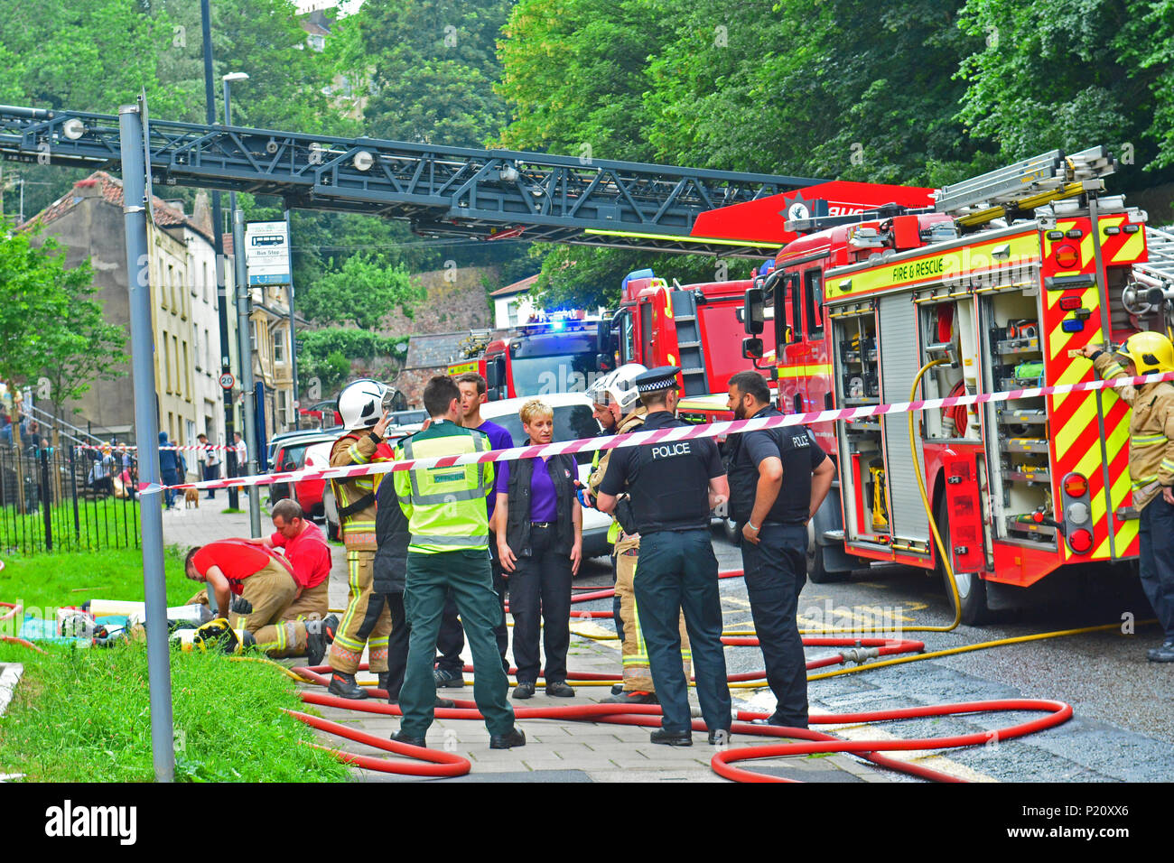 Bristol, UK. Block of flats on fire seen with smoke pouring out at Brandon House on  Jacob's Wells Road. Emergency Services arrived approx 13.00 hrs today wednesday 13th June. Road closed in both direction to all traffic. Credit: Robert Timoney/Alamy Live News - Stock Image