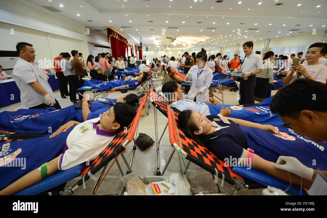 Vientiane. 14th June, 2018. People donate blood in Vientiane, Laos, June 14, 2018, the World Blood Donor Day. This year's theme is 'Be there for someone else. Give blood. Share life.' Credit: Liu Ailun/Xinhua/Alamy Live News - Stock Image