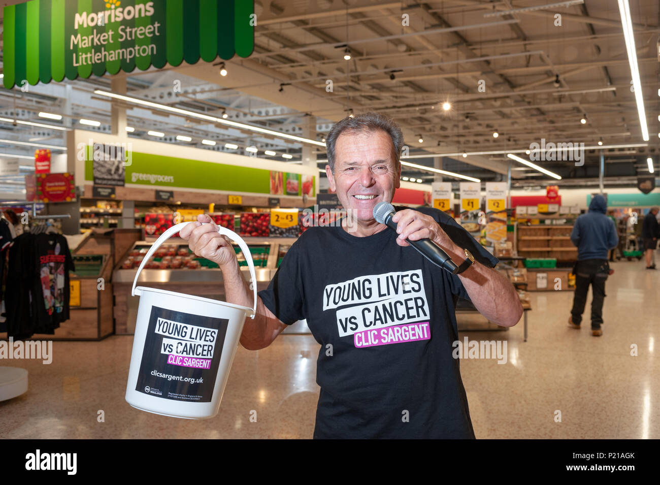 Charity supermarket singer Geoff Davis, from Falmouth, Cornwall, plans to sing in every Morrisons store in the UK. Geoff who's raising money for the CLIC Sargent charity continued his supermarket tour by visiting the Morrisons store in Wick, Littlehampton, West Sussex, England. Geoff wants to help raise money for the charity after losing his son to cancer 43 years ago and has so far raised over £20,000 and visited 40 stores across the UK. Credit: Scott Ramsey/Alamy Live News - Stock Image