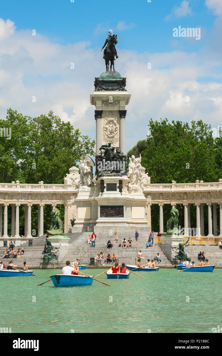 Madrid Park Retiro View On A Summer Afternoon Of People Enjoying Boat Rides On The Estanque Lake In The Parque Del Retiro In Central Madrid Spain Stock Photo Alamy