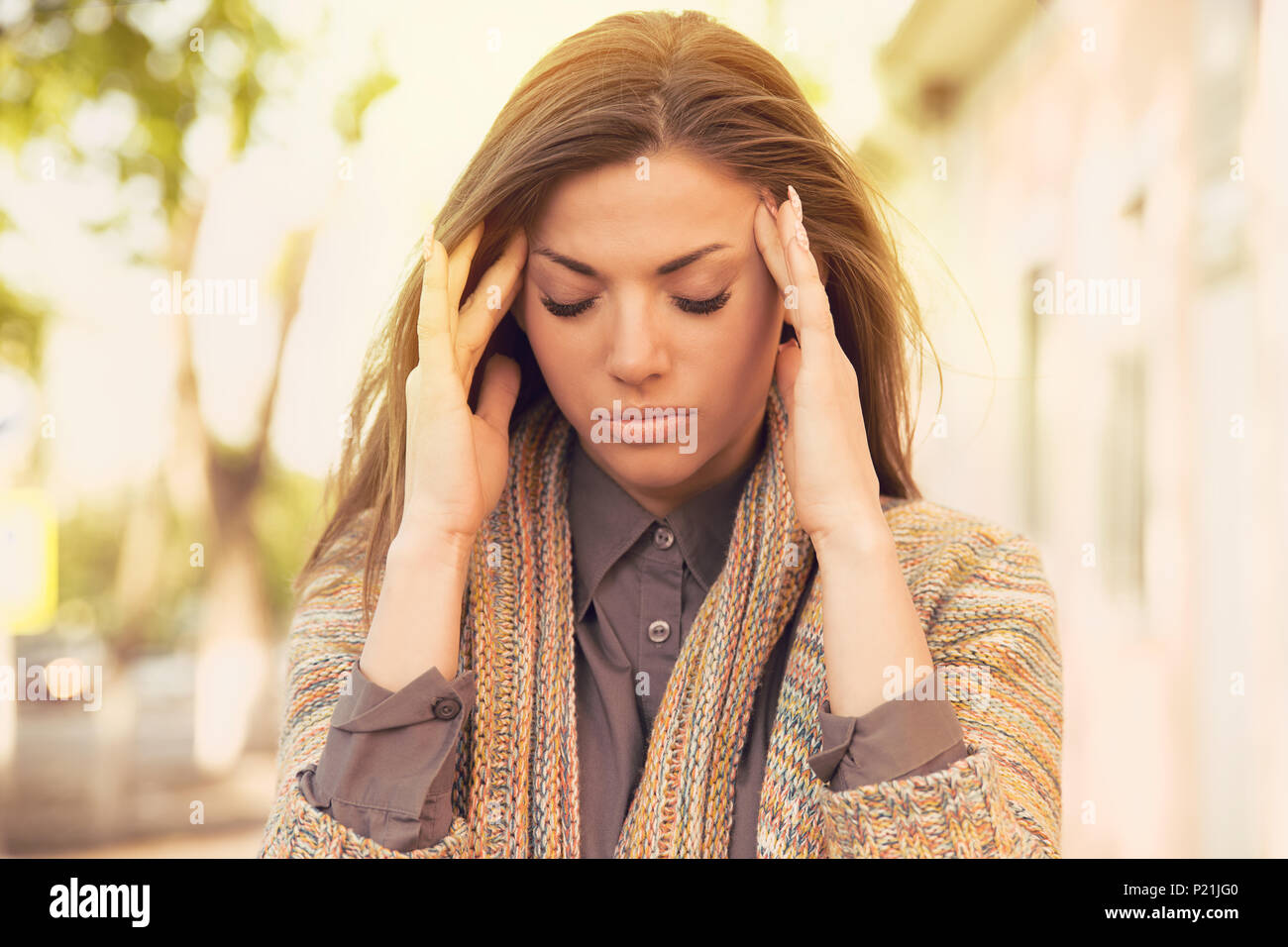 portrait stressed sad woman standing outdoors. City life style stress - Stock Image