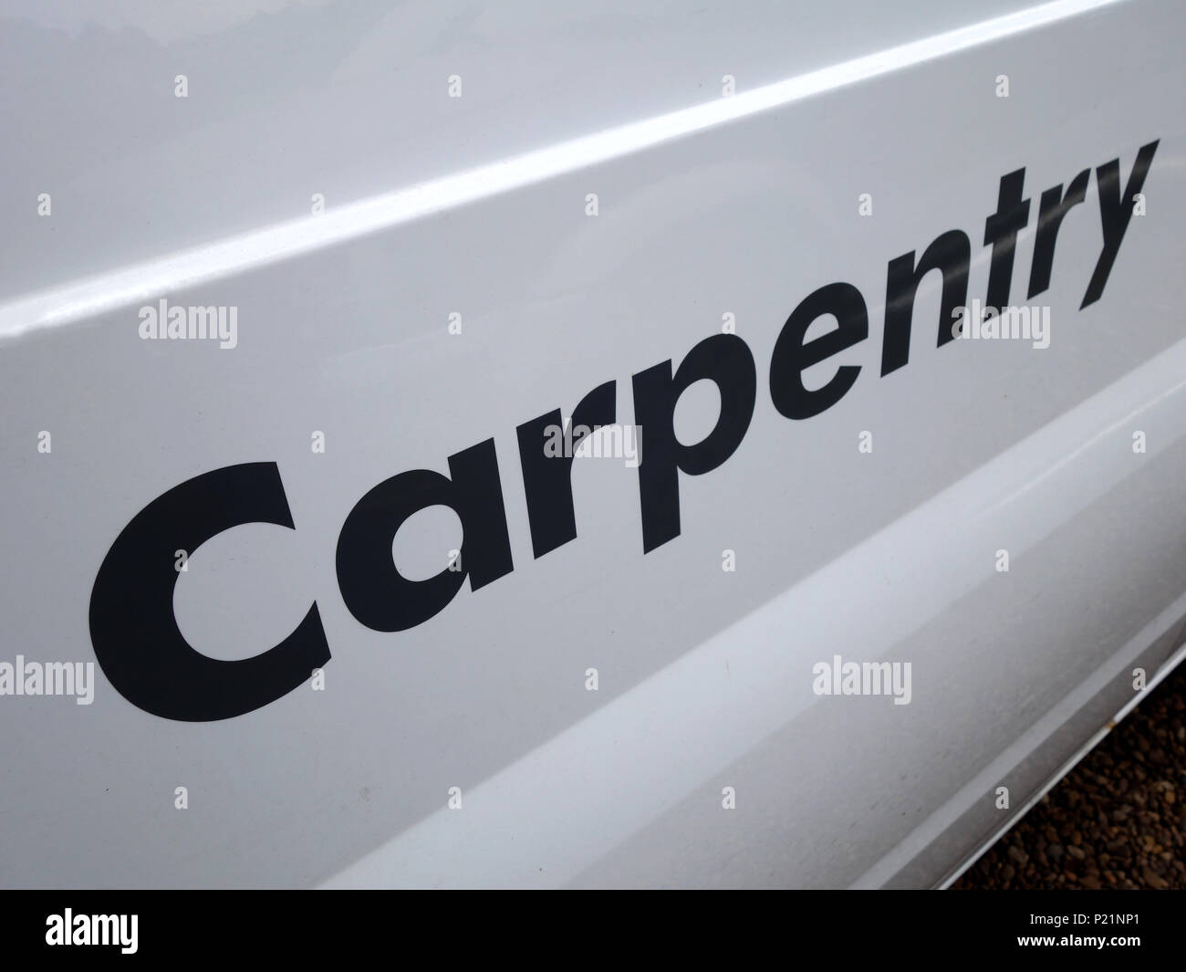 Carpentry sign writing on a Professional trades van - Stock Image