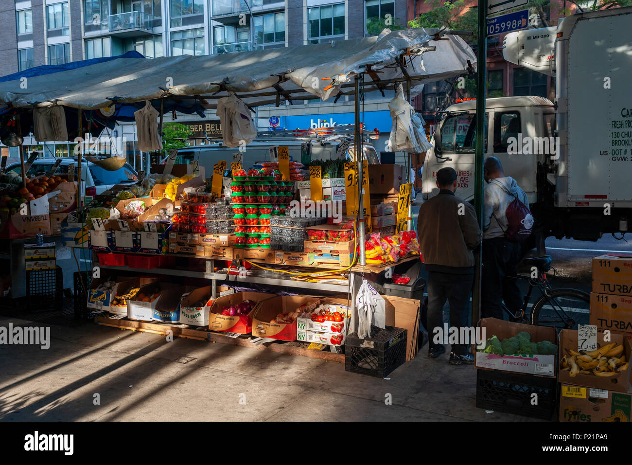 A fruit and vegetable vendor in the Chelsea neighborhood of New York on Tuesday, June 12, 2018.  (© Richard B. Levine) Stock Photo