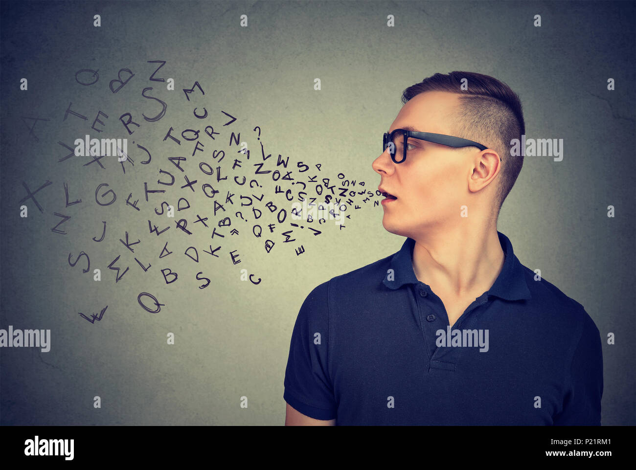 Man in glasses talking with alphabet letters coming out of his mouth. Communication, information, concept Stock Photo