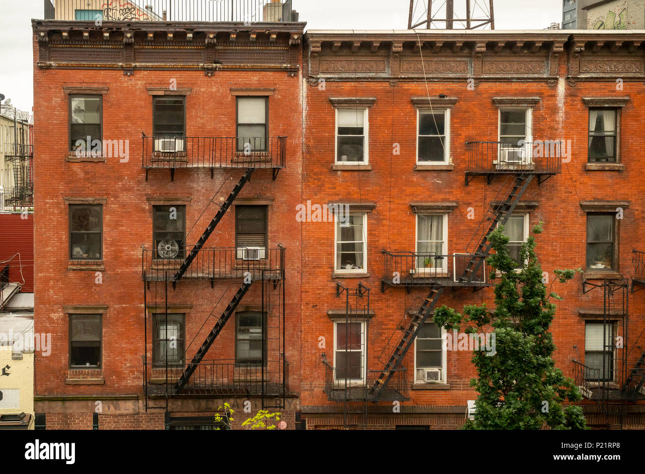 Tenements in the Greenpoint neighborhood of Brooklyn on Sunday, June 3, 2018.   Zoning changes in 2005 promoted residential development in areas previously designated industrial.(© Richard B. Levine) - Stock Image