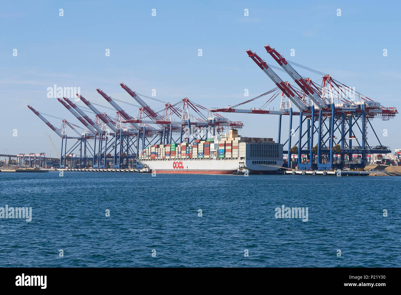 The Container Ship, OOCL LONDON, About To Depart The Long Beach Container Terminal, Port Of Long Beach, California, USA. - Stock Image