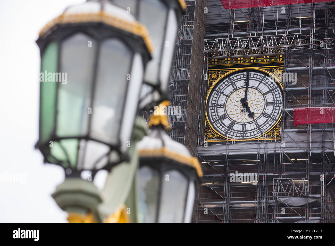Scaffolding surrounds the clock face of Big Ben Elizabeth Tower Palace of Westminster Houses of Parliament during restorations renovations repairs and Stock Photo