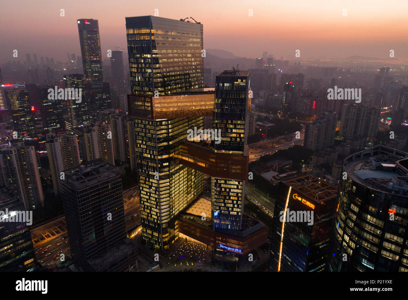Aerial view of Tencent headquarters in Shenzhen, China. The 250 meter high twin towers are connected by sky bridges and in total can house 12,000 empl - Stock Image