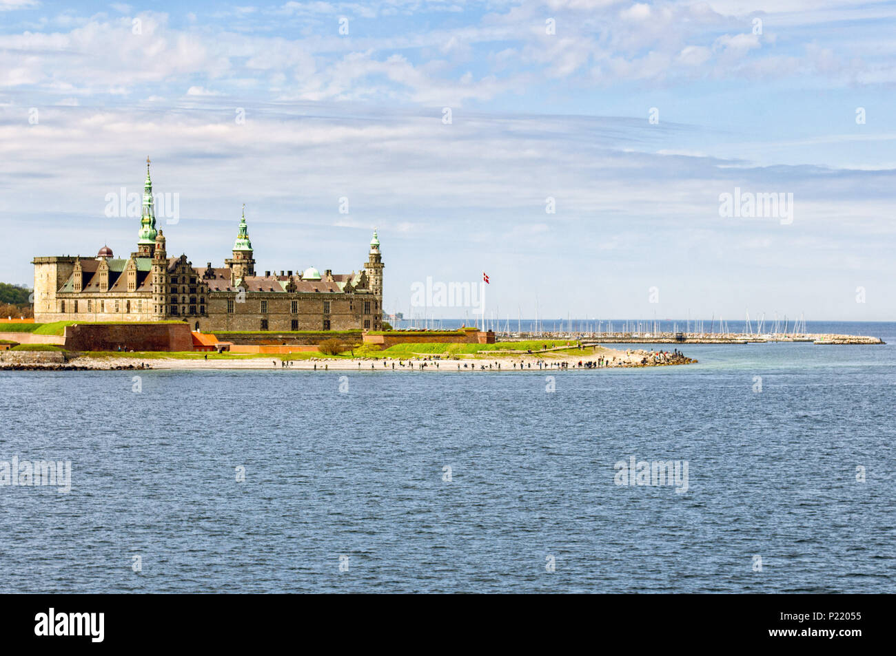 A view of Kronborg castle, the famous Hamlet's Castle with the sea and a boat in Helsingor, (Elsinore) Denmark, Europe. Shakespeare Places. - Stock Image