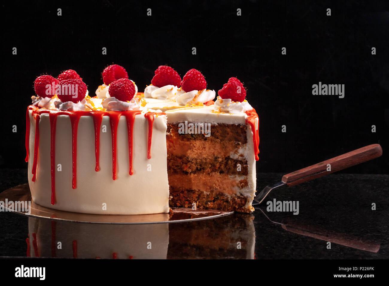 Raspberry cream mousse cake no baked cheesecake on black background - Stock Image