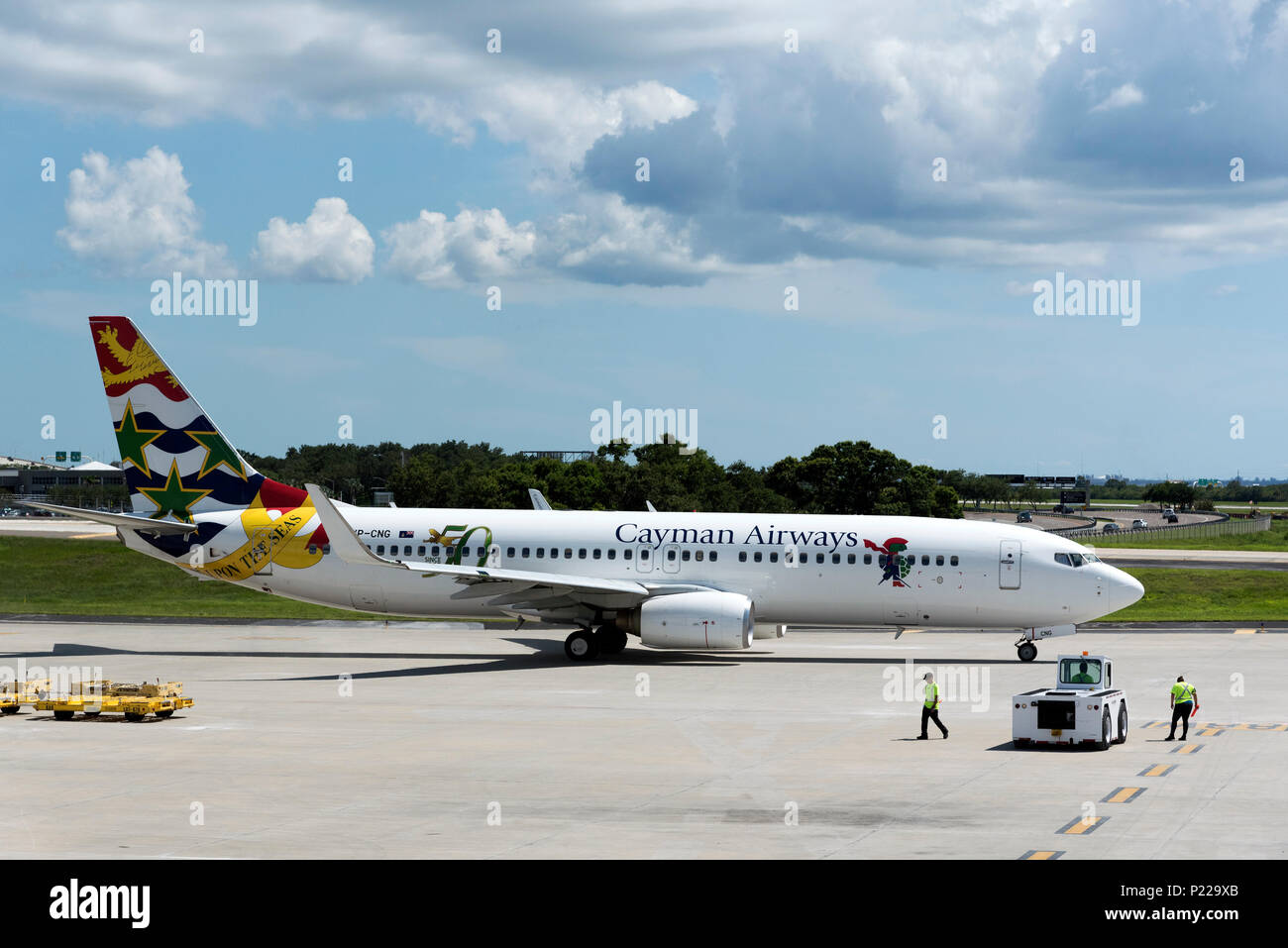 Tampa International Airport Florida USA. 2018. A Cayman Airways  passenger jet preparing to taxi from the apron. - Stock Image