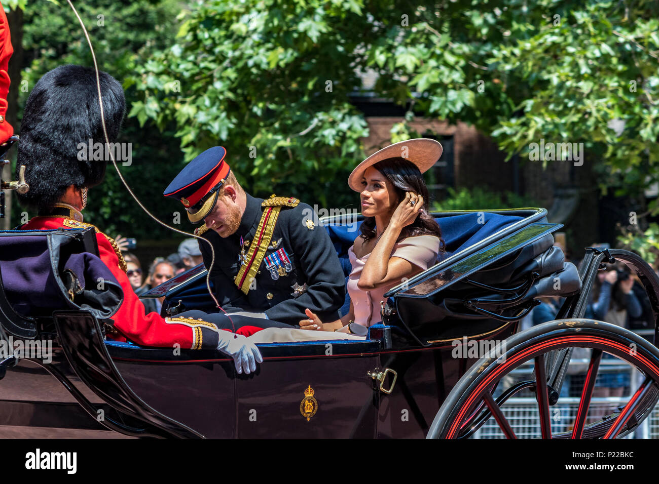 Prince Harry ,Duke of Sussex riding along The Mall in a carriage with Meghan Markle ,The Duchess Of Sussex ,at The Trooping Of The Colour  London,2018 Stock Photo