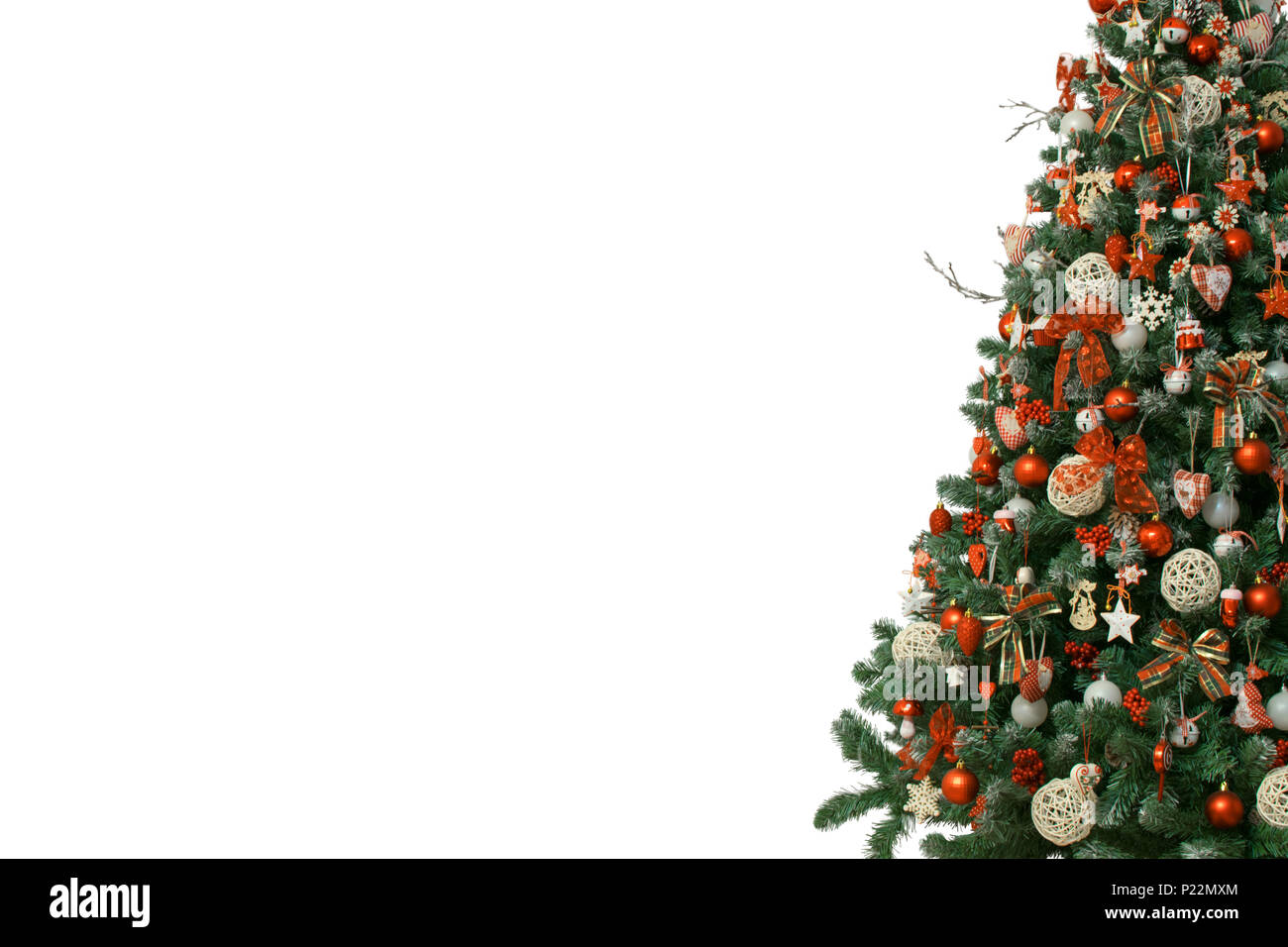half of christmas tree isolated on white background decorated with vintage ornaments wooden snowflakes red berries and ballsred white jingle bells - Christmas Tree Decorated With Vintage Ornaments