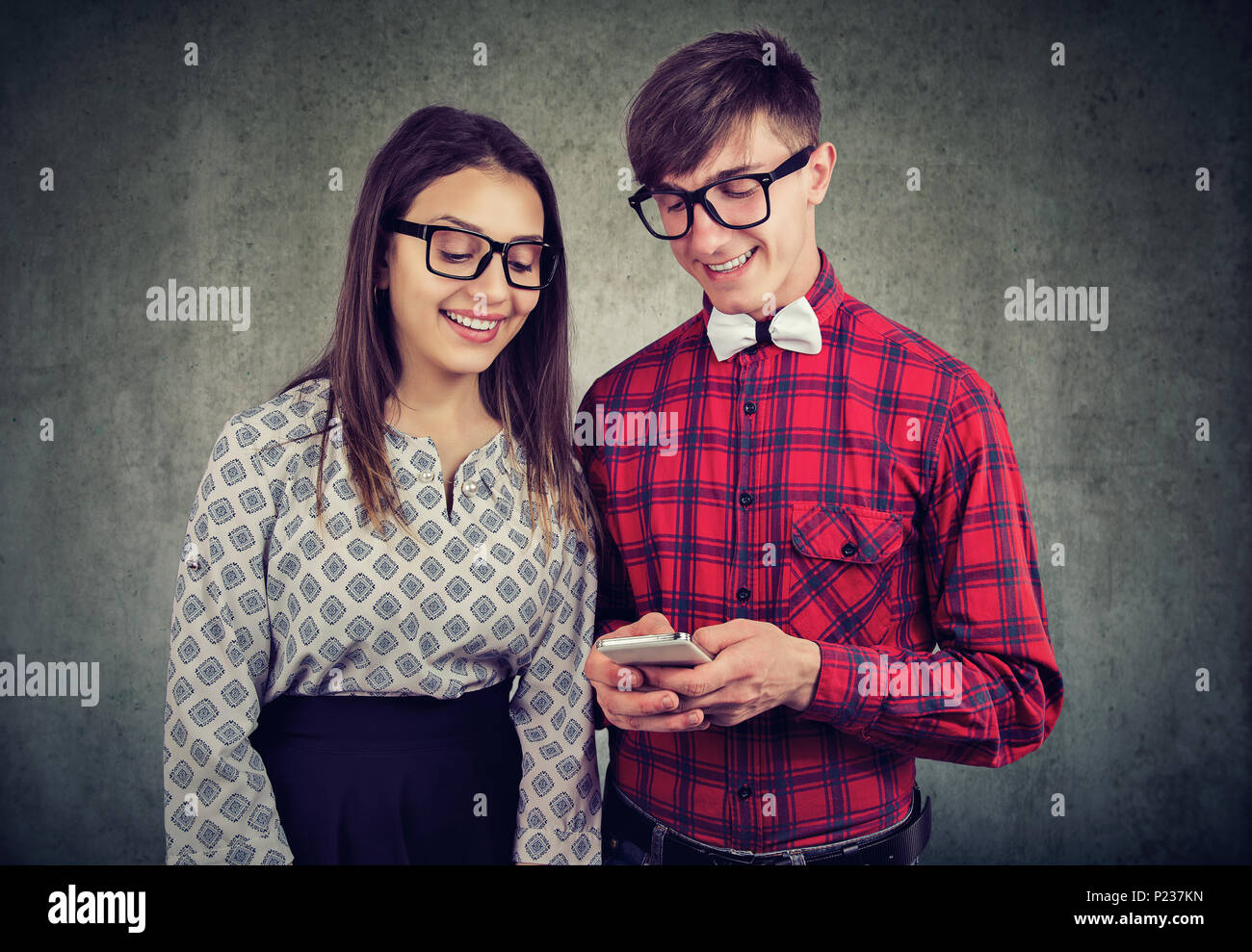 [Image: happy-eccentic-hipster-guy-holding-smart...P237KN.jpg]